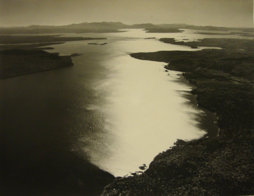 A bird's-eye-view  landscape featuring a large body of water