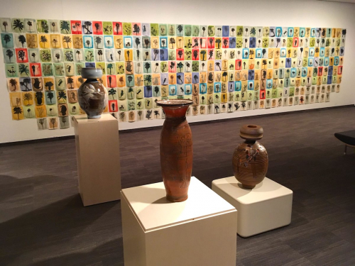 A view that includes pottery by Dean Schwarz and a large-scale installation by Paul Valadez