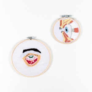 embroidery rings containing embroidered eyes