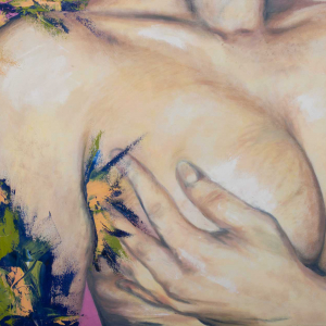 an individual's hand holding their breast