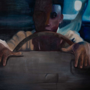 African American male behind the wheel of a vehicle